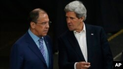 U.S. Secretary of State John Kerry, right, and Russia's Foreign Minister Sergey Lavrov talk in Kiruna, Sweden, Wednesday, May 15, 2013.