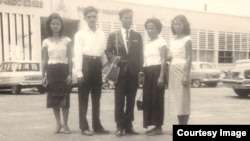 Tun Sovan, center, stands with his mother, two sisters and a brother-in-law. The photo was taken in front of Pochentong International Airport in 1962, before leaving to the United States. (Photo courtesy of Tun Sovan)
