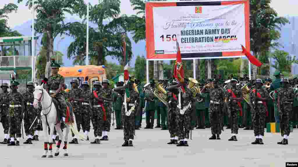 Soldiers take part in a parade for the Nigeria Army's 150th anniversary celebration in Abuja.