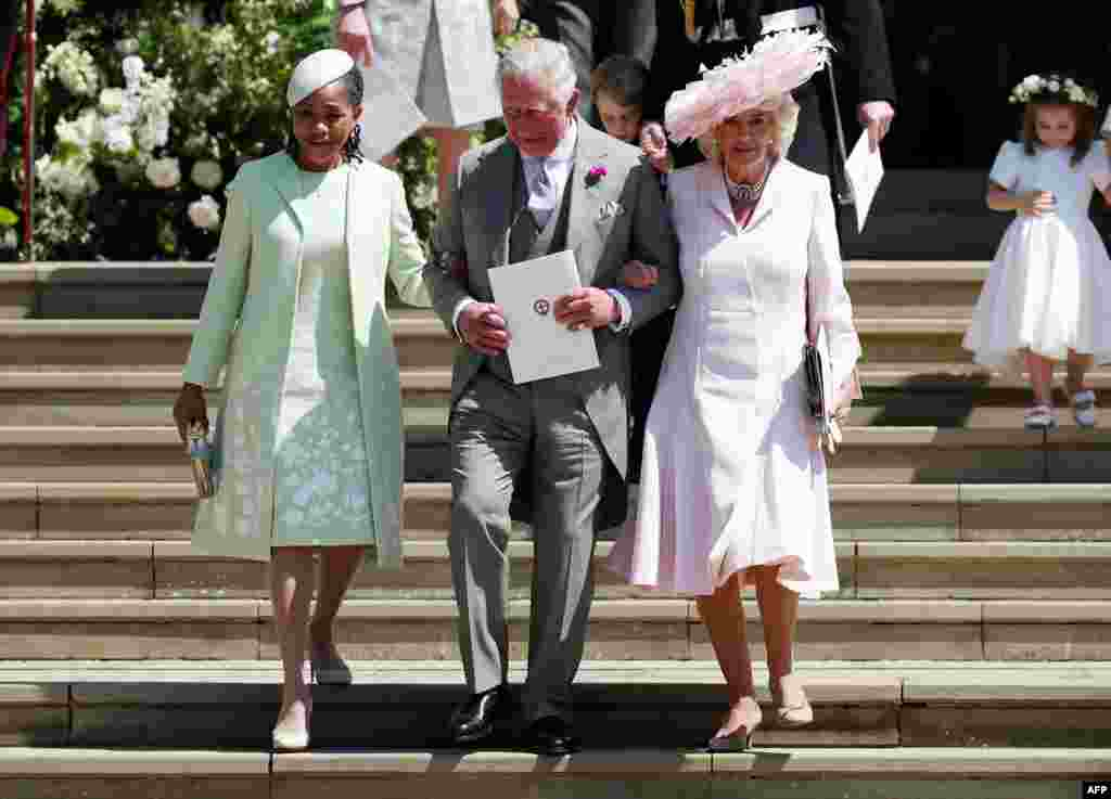 (L-R) Meghan Markle's mother Doria Ragland, Britain's Prince Charles, Prince of Wales (C) and Britain's Camilla, Duchess of Cornwall, leave after the wedding ceremony of Prince Harry and U.S. actress Meghan Markle at St George's Chapel, Windsor Castle, in Windsor, May 19, 2018