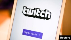 FILE - A Twitch sign-in screen is seen at the offices of Twitch Interactive Inc., a social video platform and gaming community owned by Amazon, in San Francisco, March 6, 2017.