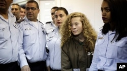 Ahed Tamimi, a 17-year-old from the West Bank village of Nebi Saleh, is brought to a courtroom inside Ofer military prison near Jerusalem, Dec. 28, 2017.