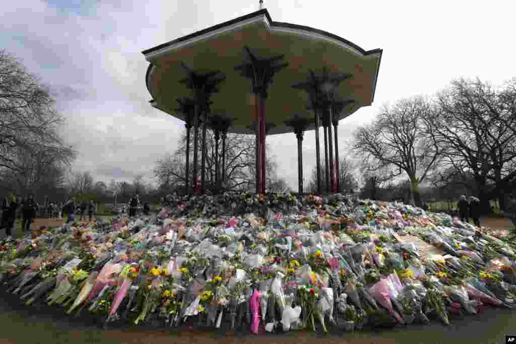Floral tributes and candles placed at the bandstand on Clapham Common in London in honor of Sarah Everard. The slaying of Everard sent shockwaves across the U.K. because a Metropolitan Police officer is charged with her kidnapping and murder.