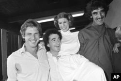 "FILE - Actor Harrison Ford, left, who played Han Solo in the move ""Star Wars,"" is pictured with his co-stars, Anthony Daniels, who played C-3P0; Carrie Fisher, who played Princess Leia; and Peter Mayhew, who played Chewbacca, as they take a break from filming a television special, Oct. 5, 1978."