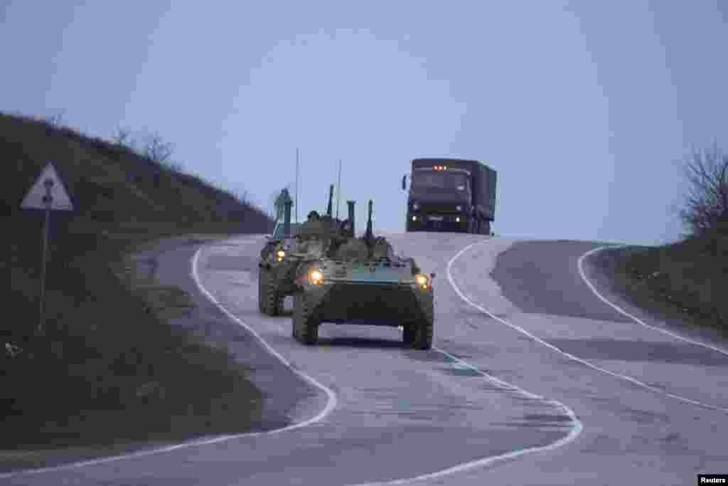Russian military armored personnel carriers drive from Sevastopol to Simferopol, Crimea, Ukraine, March 4, 2014.