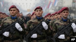 Members of the police forces of the Republika Srpska stand guard moments before a parade marking the 26th anniversary of the republic in the Bosnian town of Banja Luka, Jan. 9, 2018.