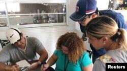 Doctors review prescriptions of patients in a elderly care facility in Orocovis, Puerto Rico, Oct. 3, 2017.