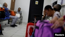 Kidney disease patients and their relatives wait at the waiting room of a dialysis center in Caracas, Venezuela, Feb. 6, 2018.