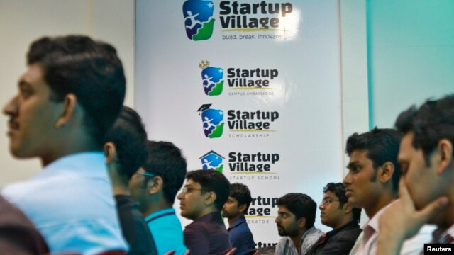 FILE - Entrepreneurs, employees and students listen to a speech during the Start-up saturday event at the Start-up Village in Kinfra High Tech Park in the southern Indian city of Kochi.