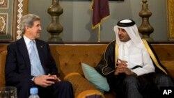 FILE - U.S. Secretary of State John Kerry meets with the Emir of Qatar Sheik Tamim bin Hamad Al Thani.