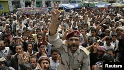 A former army officer, who defected to join anti-government protesters, shouts slogans during a rally demanding the ouster of Yemen's President Ali Abdullah Saleh in Sana'a October 4, 2011.