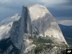 Half Dome and Yosemite Valley in a view from Glacier Point at Yosemite National Park, California