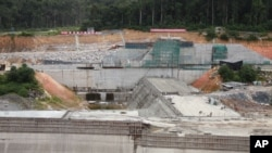 The construction of one of the hydroelectric dam at Poubara, which the government is financing. It is one of many dams under construction to meet the energy demands of anticipated investment companies.