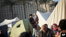 Anti-Mubarak protesters are seen next to their tents at Tahrir Square in Cairo, Egypt, Wednesday, February 9, 2011