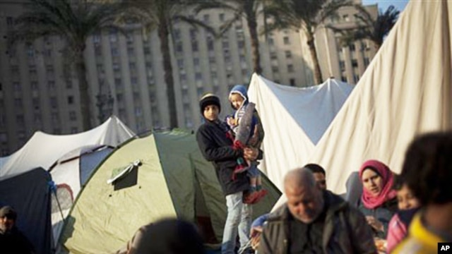Egyptian anti-Mubarak protesters are seen next to their tents at Tahrir Square in Cairo, Egypt, Wednesday, February 9, 2011