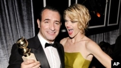 "French actor and winner of the Golden Globe for Best Performance by an Actor in a Motion Picture - Comedy or Musical for his role in ""The Artist"" Jean Dujardin and cast member Missi Pyle (R) attend The Weinstein Company after party after the 69th annual G"