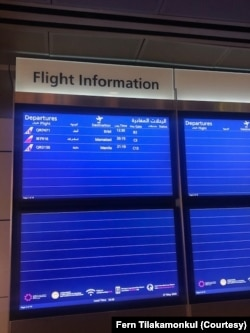 Flight information at an airport shows that airlines cut flights during the coronavirus pandemic.