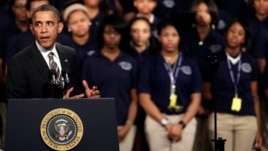 President Barack Obama speaks about strengthening the economy for the middle class and the nation's struggle with gun violence, at an appearance at Hyde Park Academy, in Chicago, Feb. 15, 2013.