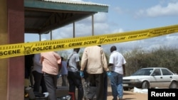 Kenyan security forces secure the African Inland Church after an attack in Kenya's northern town of Garissa, July 1, 2012.