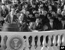 In this Jan. 20, 1961, file photo, President John F. Kennedy gives his inaugural address at the Capitol in Washington