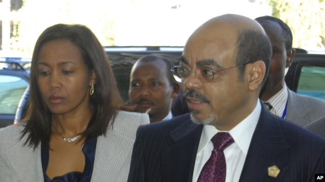 Ethiopia Prime Minister Meles Zenawi with First Lady Azeb Mesfin arrive at the African Union summit being held in Addis Ababa, January 30, 2011.