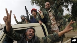 Anti-Gadhafi fighters celebrate in Libyan city of Benghazi, Feb. 27, 2011.