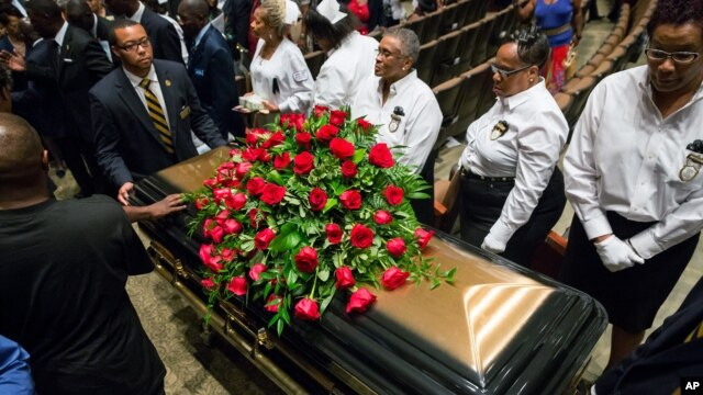 A casket containing the body of Michael Brown is wheeled out at Friendly Temple Missionary Baptist Church in St. Louis, Missouri, Aug. 25, 2014.
