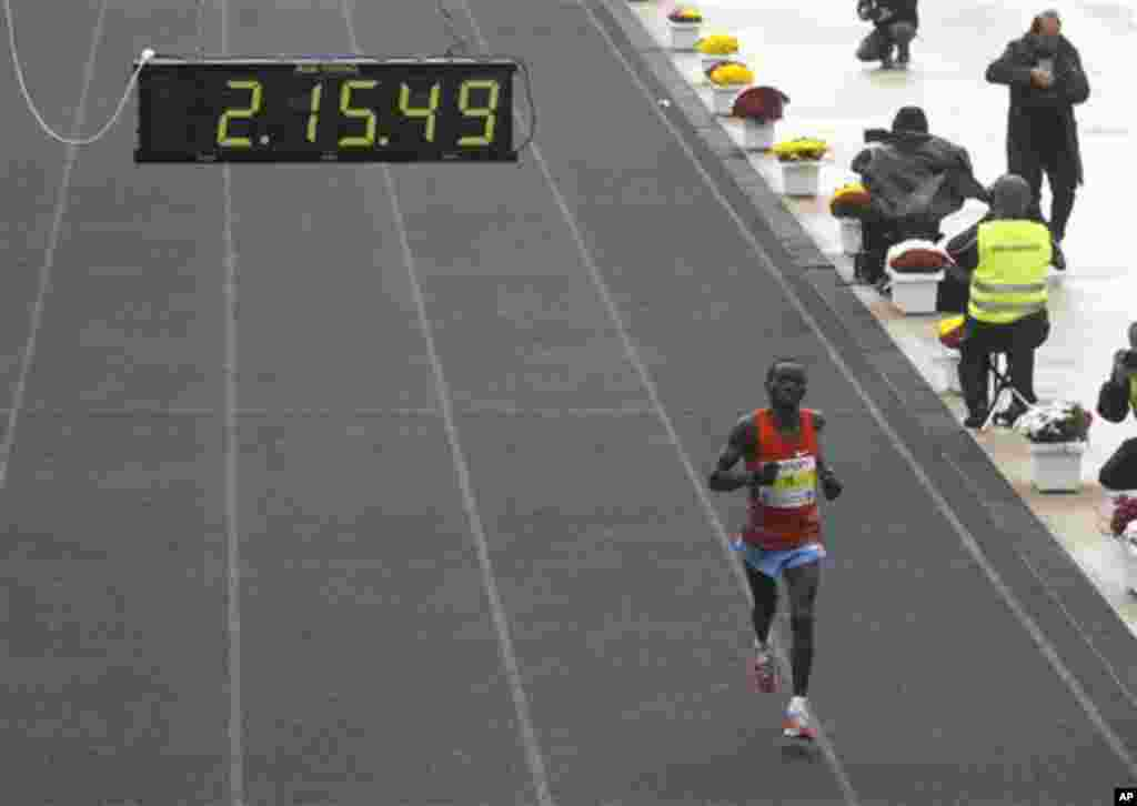 Daniel Ndiritu Gatheru of Kenya finishes third the Athens Classic Marathon at the Panathinaikon Stadium in Athens, on Sunday, Nov. 13, 2011. About 18,000 people took part in the marathon and two shorter races of 5 kms and 10 kms as the race was run in c