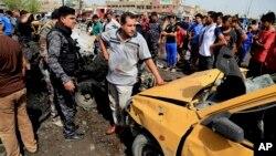 Сили безпеки на місці вибуху на ринку в шиїтському районі Багдада
