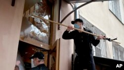 A pro-Russian protester breaks windows at a police station building in Odessa, Ukraine, on May 4, 2014.