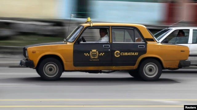 A man drives his Soviet-era Russian Lada taxi in Havana, Jan. 8, 2014.