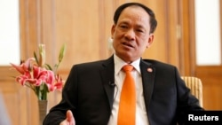 Association of Southeast Asian Nations (ASEAN) Secretary-General Le Luong Minh speaks during a Reuters interview at a hotel in Naypyitaw, Nov. 11, 2014.