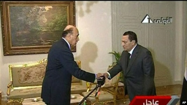 In this image taken from TV, Egyptian President Hosni Mubarak, right, shakes the hand of Omar Suleiman, who was sworn in as Vice President of Egypt, Jan 29, 2011