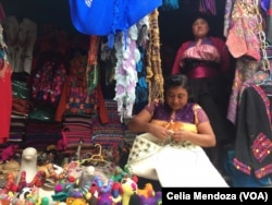 Indigenous women weave wool to sell. San Juan Chamula, Mexico, Feb. 15, 2016.