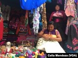 Indigenous women weave wool to sell. San Juan Chamula, Mexico, Feb. 15, 2016.