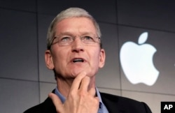 FILE - Apple CEO Tim Cook responds to a question during a news conference at IBM Watson headquarters, in New York, April 30, 2015. Cook says his company will not comply with a judge's ruling calling on Apple to help the FBI gain access to a locked iPhone.