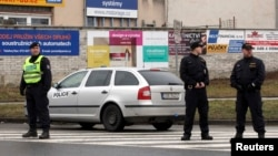 Police stand near the site of a shooting in the eastern Czech town of Uhersky Brod Feb. 24, 2015.