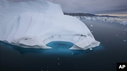 FILE - An iceberg is seen melting off the coast of Ammasalik, Greenland, July 19, 2007.