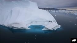 FILE - An iceberg is seen melting off the coast of Ammasalik, Greenland, July 19, 2007.