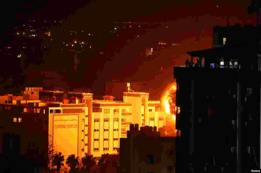 Flame and smoke are seen during an Israeli air strike in Gaza City in the Gaza Strip, following a rocket strike on Tev Aviv that damaged a house and injured several people.