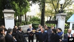 Greek Prime Minister George makes statements outside the presidential palace after his meeting with the Greek President Karolos Papoulias in Athens, October 17, 2011.