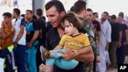 Islamic militants overran parts of the Iraqi city of Mosul, sending refugees fleeing to the country's self-ruled northern Kurdish region on June 10, 2014.
