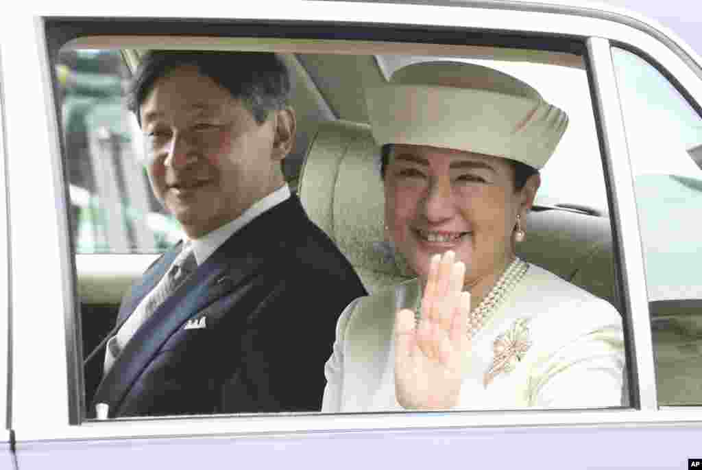 Japan's new Emperor Naruhito and new Empress Masako are driven to Imperial Palace to greet Emperor Emeritus Akihito and Empress Emerita Michiko in Tokyo.