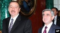 FILE- Azerbaijan President Aliyev, left, and Armenia President Sarkisian attend the CIS summit in Moscow, Dec. 10, 2010.