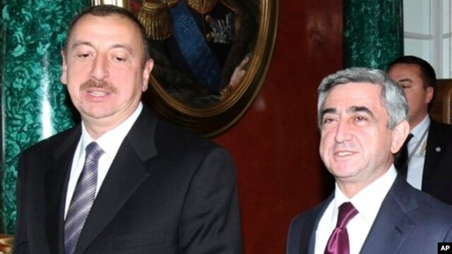 FILE- Azerbaijan President Aliyev, left, and Armenia President Sarkisian attend the CIS summit in  Moscow, Dec. 10, 2010.