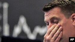 Stock trader Michael Pansegrau reacts at the German stock exchange in Frankfurt, central Germany, Aug. 5, 2011