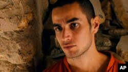 """FILE - This file photo released by Adopt Films shows Adam Bakri in a scene from the film """"Omar."""""""