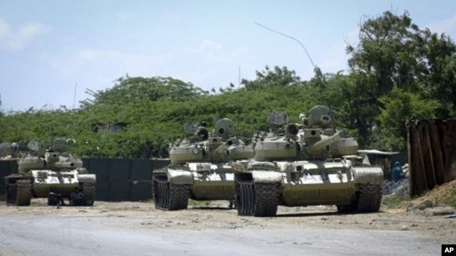 African Union tanks are seen guarding in front of their base in the Somali capital of Mogadishu, October 29, 2011.