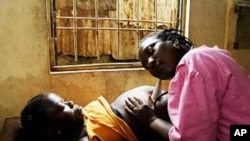 FILE - Childbirth in Africa.