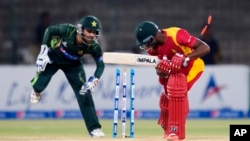 FILE: Pakistan's Mohammad Rizwan unsuccessfully tries to remove stumps of Zimbabwe's Vusimuzi Sibanda during a match at the Gaddafi Stadium in Lahore, Pakistan, Sunday, May 24, 2015. (AP Photo/B.K. Bangash)